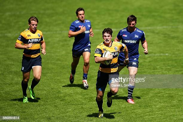 Owen Jenkins of Cardiff Blues breaks away to score a try for his side during the Singha Premiership Rugby 7s Series Final between Cardiff Blues and...