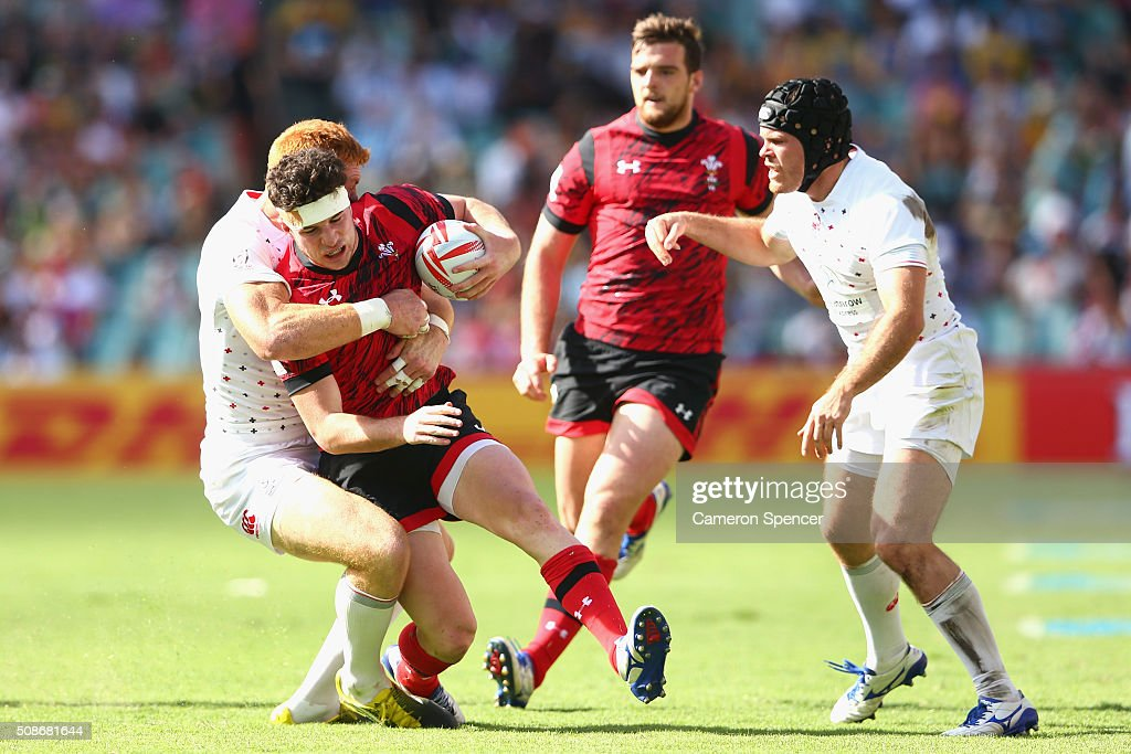Owen Jenkins of Wales is tackled during the 2016 Sydney Sevens match between England and Wales at Allianz Stadium on February 6, 2016 in Sydney, Australia.