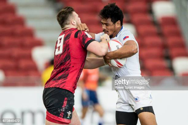 Owen Lane of Wales tries to tackle Tila Mealoi of Samoa during the match Wales vs Samoa Day 2 of the HSBC Singapore Rugby Sevens as part of the World...