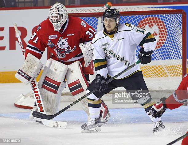 Owen MacDonald of the London Knights looks for a pass in front of Alex Nedeljkovic of the Niagara IceDogs during Game Four of the OHL Championship...