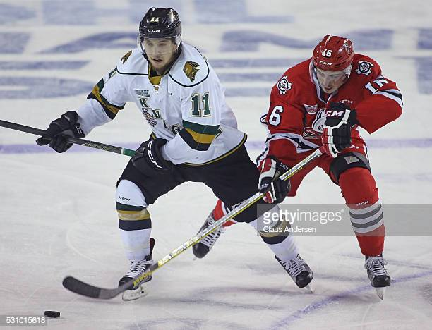 Owen MacDonald of the London Knights skates away from a checking Tyler Boston of the Niagara IceDogs during Game Four of the OHL Championship final...