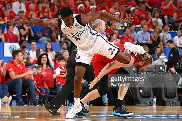 Owen Odigie of United gets tangled up with Jesse Wagstaff of the Wildcats during the round 10 NBL match between the Perth Wildcats and Melbourne...