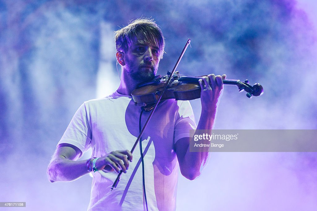 Owen Pallett performs on stage with Caribou at Field Day Festival on June 6 2015 in London England