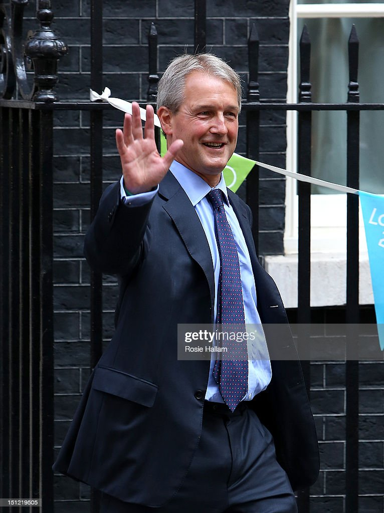 Owen Paterson leaves No 10 Downing Street as Environment Secretary on the day Prime Minister David Cameron holds a government reshuffle on September...