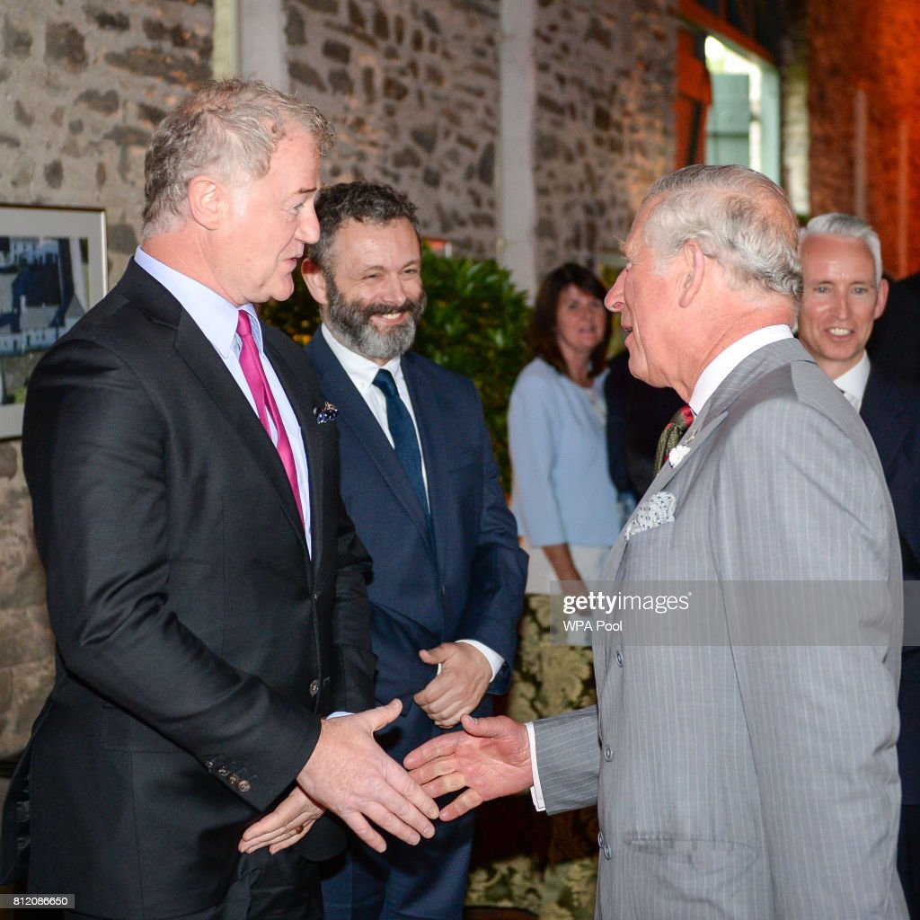 Owen Teale (L) and Martin Sheen greet Prince Charles, Prince of Wales at his Welsh home near Llandovery, where he is hosting a music and drama evening, also featuring performances by students of the Royal Welsh College of Music and Drama on July 10, 2017 in Ceredigion, Wales.
