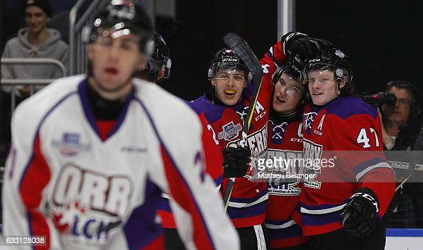 Owen Tippett of Team Cherry is congratulated by teammates Maxime Comtois and Nolan Patrick after scoring a goal against Team Orr during the third...