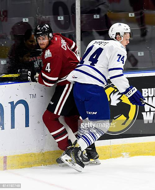 Owen Tippett of the Mississauga Steelheads puts a hit on Noah Carroll of the Guelph Storm during game action at Hershey Centre on October 12 2016 in...