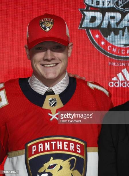 Owen Tippett tenth overall pick of the Florida Panthers poses for a photo onstage during Round One of the 2017 NHL Draft at United Center on June 23...