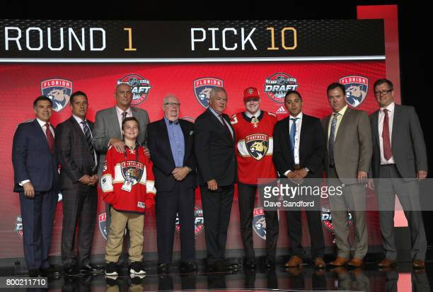 Owen Tippett tenth overall pick of the Florida Panthers poses for a photo onstage with the Panthers draft team during Round One of the 2017 NHL Draft...