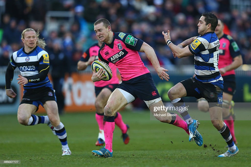 Owen Williams (C) of Cardiff Blues escapes from Horacio Agulla (R) of Bath during the LV Cup match between Bath and Cardiff Blues at the Recreation Ground on January 25, 2014 in Bath, England.