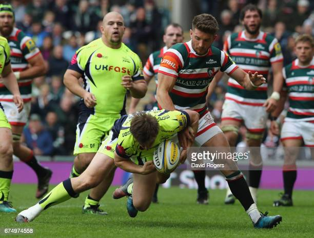 Owen Williams of Leicester pounces on the ball after a mistake by AJ MacGinty to score their third try during the Aviva Premiership match between...