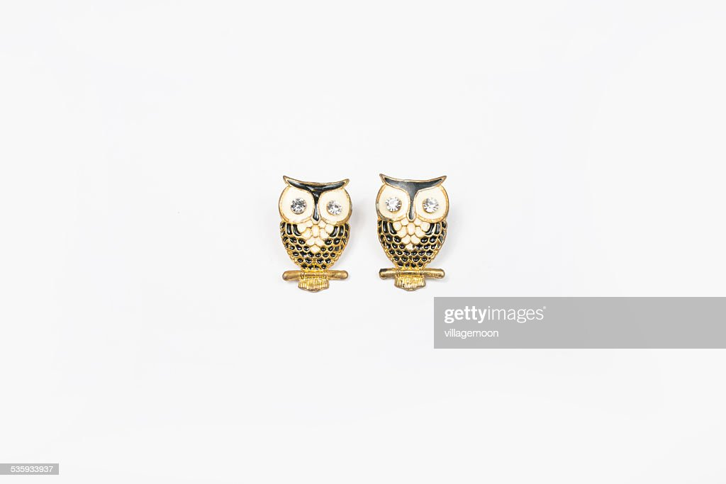 owl earring on white background : Stock Photo