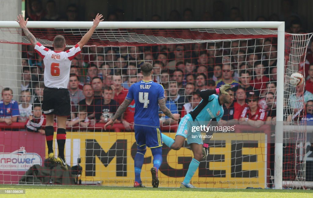 Own goal by Adam Rooney of Swindon Town during the npower League One Play Off Semi Final, Second Leg match between Brentford and Swindon Town at Griffin Park on May 6, 2013 in Brentford, England.