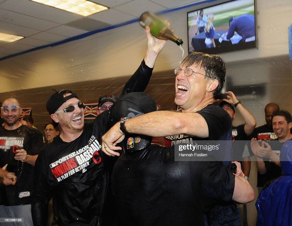 Owner and CEO Paul Dolan of the Cleveland Indians celebrates with his team in the clubhouse after a win of the game against the Minnesota Twins on September 29, 2013 at Target Field in Minneapolis, Minnesota. The Indians defeated the Twins 5-1 and clinched a American League Wild Card berth.