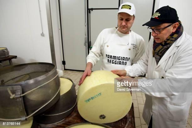 Owner and head cheesemaker Claudio and Igino Morini a representative of the Consorzio ParmigianoReggiano the statesanctioned consortium responsible...
