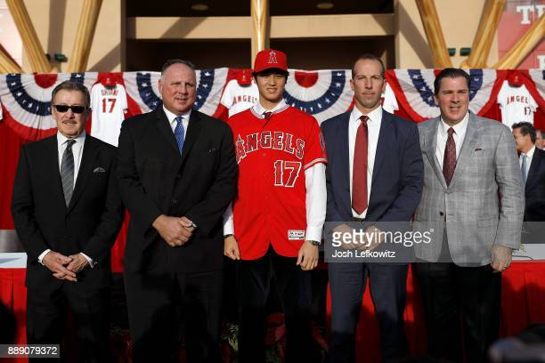Owner Arte Moreno Manager Mike Scioscia Shohei Ohtani General Manager Billy Eppler and President John Carpino pose for the media after a press...