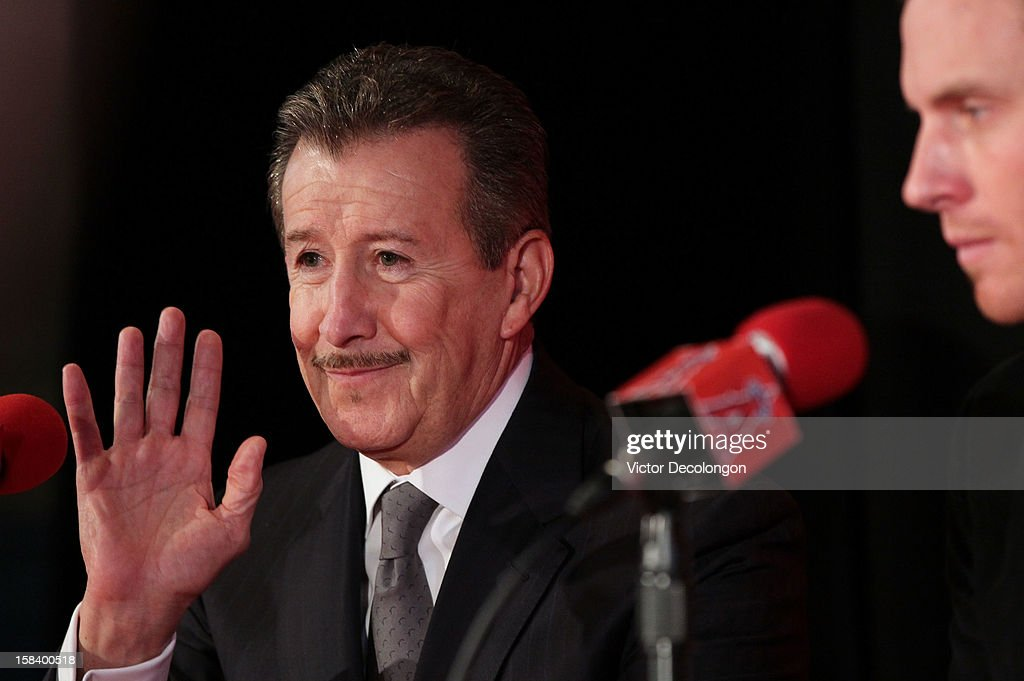 Owner Arte Moreno of the Los Angeles Angels of Anaheim waves to the audience during the press conference to introduce Josh Hamilton (R) as the team's newest member at ESPN Zone at Downtown Disney on December 15, 2012 in Anaheim, California.