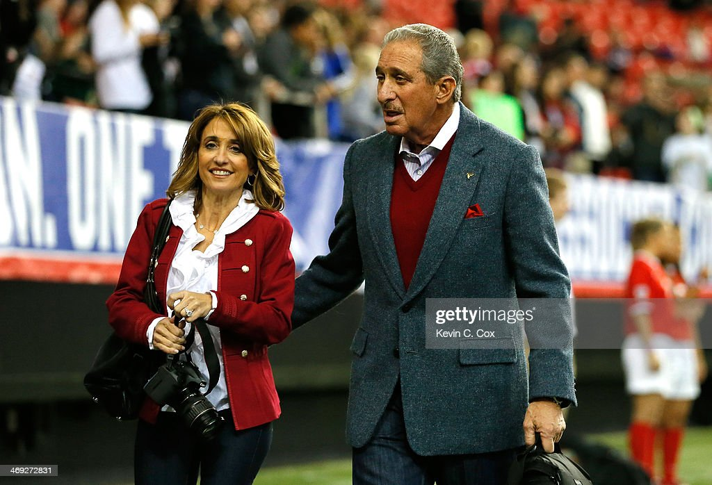 Owner Arthur Blank of the Atlanta Falcons and Angela Macuga walk the pitch prior to the match between the United States Women's National Team and the...