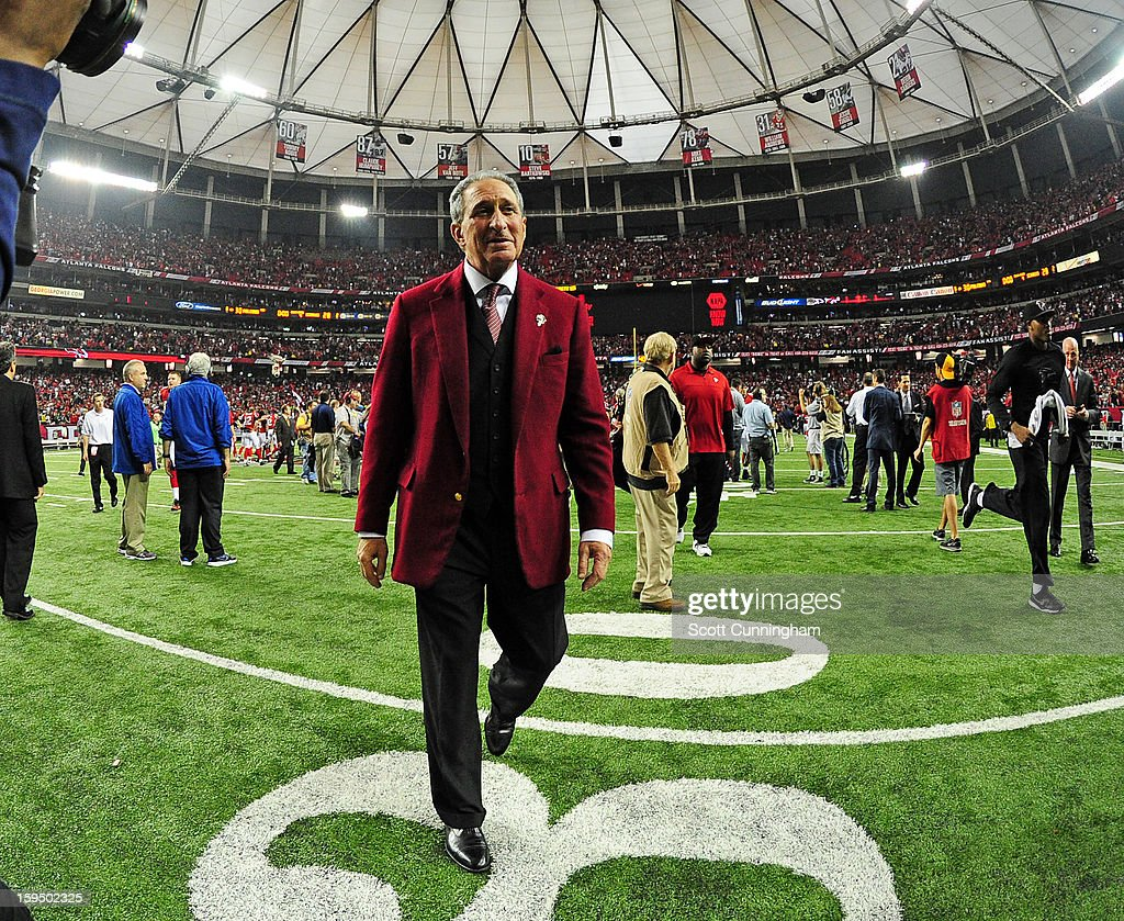 Owner Arthur Blank of the Atlanta Falcons celebrates after the NFC Divisional Playoff Game against the Seattle Seahawks at the Georgia Dome on...