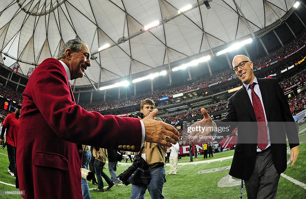 Owner Arthur Blank of the Atlanta Falcons celebrates with Falcons President Rich McKay after the NFC Divisional Playoff Game against the Seattle Seahawks at the Georgia Dome on January 13, 2013 in Atlanta, Georgia