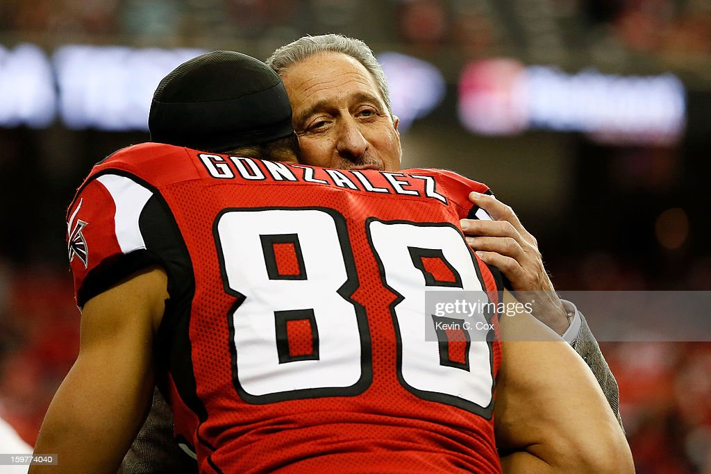 Owner Arthur Blank of the Atlanta Falcons hugs tight end tight end Tony Gonzalez #88 before the Falcons take on the San Francisco 49ers in the NFC Championship game at the Georgia Dome on January 20, 2013 in Atlanta, Georgia.