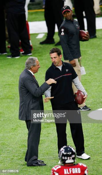 Owner Arthur Blank of the Atlanta Falcons talks with Offensive Coordinator Kyle Shanahan on the field prior to Super Bowl 51 against the New England...