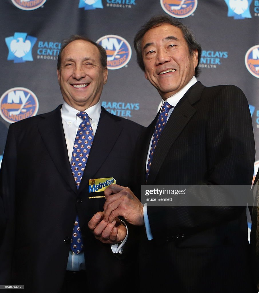Owner Bruce Ratner of the Brooklyn Nets welcomes owner Charles Wang and the New York Islanders to Brooklyn after the announcement of the franchises relocation in 2015 at a press conference at the Barclays Center on October 24, 2012 in the Brooklyn borough of New York City.