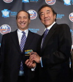 Owner Bruce Ratner of the Brooklyn Nets welcomes owner Charles Wang and the New York Islanders to Brooklyn after the announcement of the franchises...