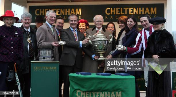 Owner Chris Jones is presented with the cup after his horse Tiger Cry ridden by Davy Russell and trained by Arthur Moore won the Johnny Henderson...