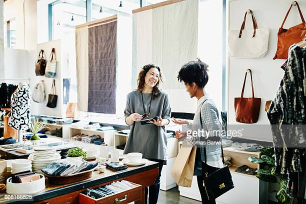 Owner completing transaction on digital tablet