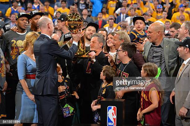 Owner Dan Gilbert of the Cleveland Cavaliers accepts the NBA championship trophy against the Golden State Warriors during the 2016 NBA Finals Game...