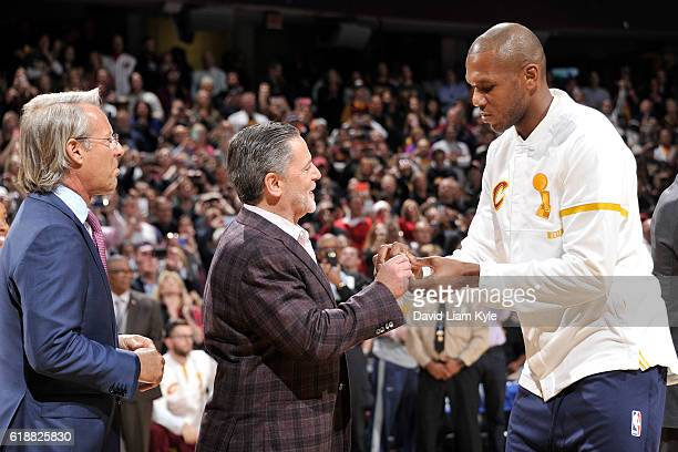 Owner Dan Gilbert presents James Jones of the Cleveland Cavaliers with his championship ring before the game against the New York Knicks on October...