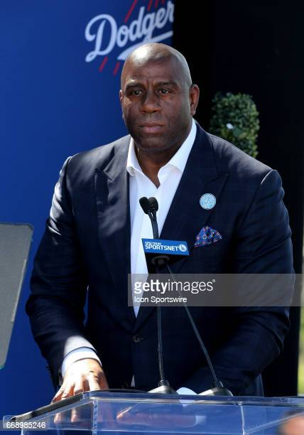 Owner Earvin 'Magic' Johnson gives a speech during the Jackie Robinson statue unveiling before the game against the Arizona Diamondbacks on April 15...