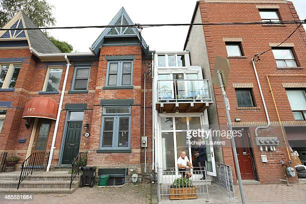 Owner George is in front of his house with his real estate broker Frank Leo in the doorway An eightfoot wide house is for sale in Regent Park for...