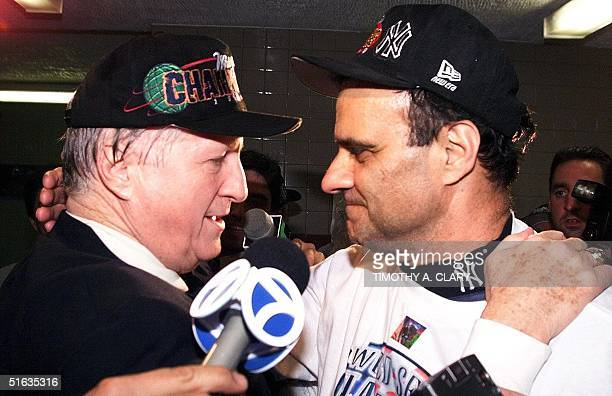 Owner George Steinbrenner and manager Joe Torre of the New York Yankees embrace in the locker room after the Yankees won game four of the World...