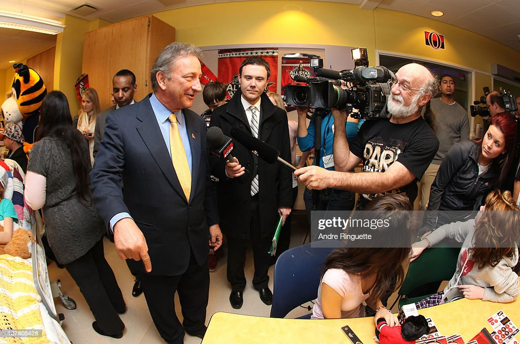 Owner, governor and chairman Eugene Melnyk of the Ottawa Senators visits with young patients at the unveiling of the NHL All-Star Legacy Playroom at Children's Hospital of Eastern Ontario on January 27, 2012 in Ottawa, Canada.