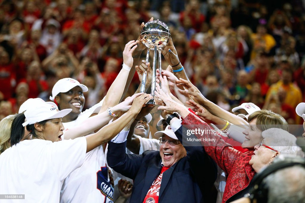 Owner Herb Simon of the Indiana Fever hoists the WNBA Championship trophy after defeating the Minnesota Lynx in Game Four of the 2012 WNBA Finals on October 21, 2012 at Bankers Life Fieldhouse in Indianapolis, Indiana.