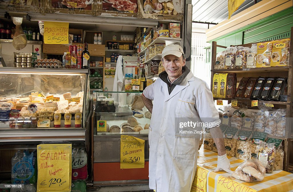owner in front of delicatessen store : Stock Photo