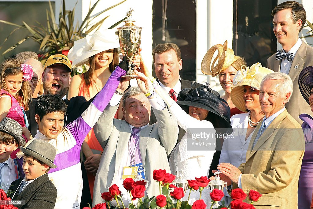 Owner J. Paul Reddam (C) and Mario Gutierrez celebrate after their horse I'll Have Another won the 138th running of the Kentucky Derby at Churchill Downs on May 5, 2012 in Louisville, Kentucky.