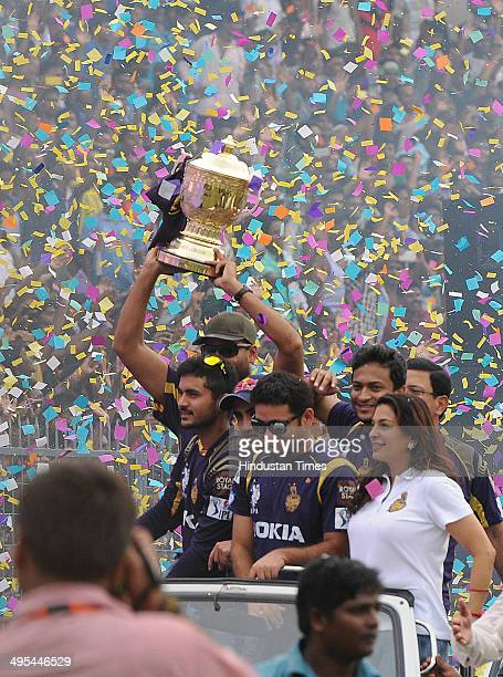 KKR owner Juhi Chawla with Piyush Chawla and other players carrying the champions trophy during felicitation ceremony of the IPL champions Kolkata...