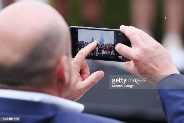NBL owner Larry Kestelman takes pictures during the 2017/18 NBL and WNBL Season Launch at Crown Towers on September 11 2017 in Melbourne Australia