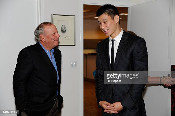 Owner Les Alexander speaks Jeremy Lin of the Houston Rockets prior to a press conference on July 19 2012 at the Toyota Center in Houston Texas NOTE...