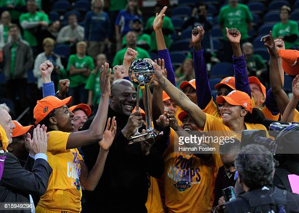 Owner Magic Johnson of the Los Angeles Sparks holds the Championship Trophy for his team after a win in Game Five of the 2016 WNBA Finals against the...