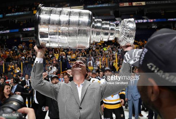 Owner Mario Lemieux of the Pittsburgh Penguins lifts the Stanley Cup after the Penguins defeated the Nashville Predators 20 to win Game Six of the...