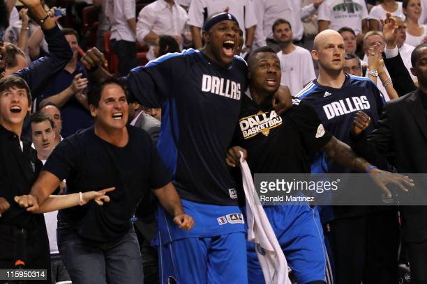 Owner Mark Cuban Brendan Haywood and DeShawn Stevenson of the Dallas Mavericks react on the bench late in the fourth quarter while taking on the...