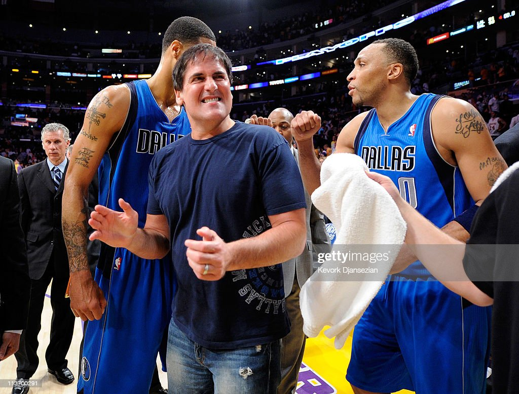 Owner <a gi-track='captionPersonalityLinkClicked' href=/galleries/search?phrase=Mark+Cuban&family=editorial&specificpeople=203295 ng-click='$event.stopPropagation()'>Mark Cuban</a> of the Dallas Mavericks celebrates with <a gi-track='captionPersonalityLinkClicked' href=/galleries/search?phrase=Tyson+Chandler&family=editorial&specificpeople=202061 ng-click='$event.stopPropagation()'>Tyson Chandler</a> #6 and <a gi-track='captionPersonalityLinkClicked' href=/galleries/search?phrase=Shawn+Marion&family=editorial&specificpeople=201566 ng-click='$event.stopPropagation()'>Shawn Marion</a> #0 after the Mavericks 93-81 victory against the Los Angeles Lakers in Game Two of the Western Conference Semifinals in the 2011 NBA Playoffs at Staples Center on May 4, 2011 in Los Angeles, California.