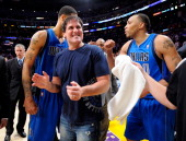 Owner Mark Cuban of the Dallas Mavericks celebrates with Tyson Chandler and Shawn Marion after the Mavericks 9381 victory against the Los Angeles...