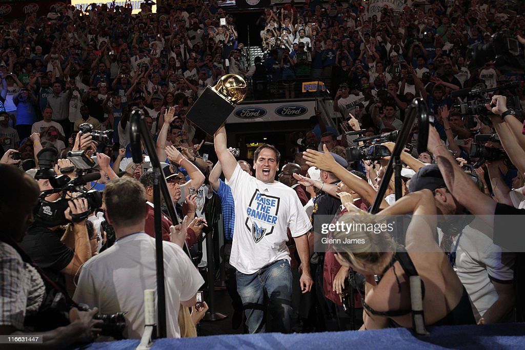 Owner <a gi-track='captionPersonalityLinkClicked' href=/galleries/search?phrase=Mark+Cuban&family=editorial&specificpeople=203295 ng-click='$event.stopPropagation()'>Mark Cuban</a> of the Dallas Mavericks takes to the stage holding the Larry O' Brien trophy during the Mavericks NBA Champion Victory Parade on June 16, 2011 at the American Airlines Center in Dallas, Texas.