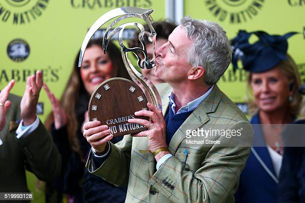 Owner Michael O'Leary kisses the winner's trophy in the Winners' Enclosure after David Mullins rode Rule The World to victory in the 2016 Crabbie's...