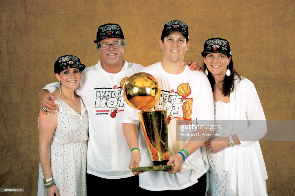 Owner Micky Arison of the Miami Heat poses for a portrait with the Larry O'Brien Trophy after defeating the San Antonio Spurs in Game Seven of the...